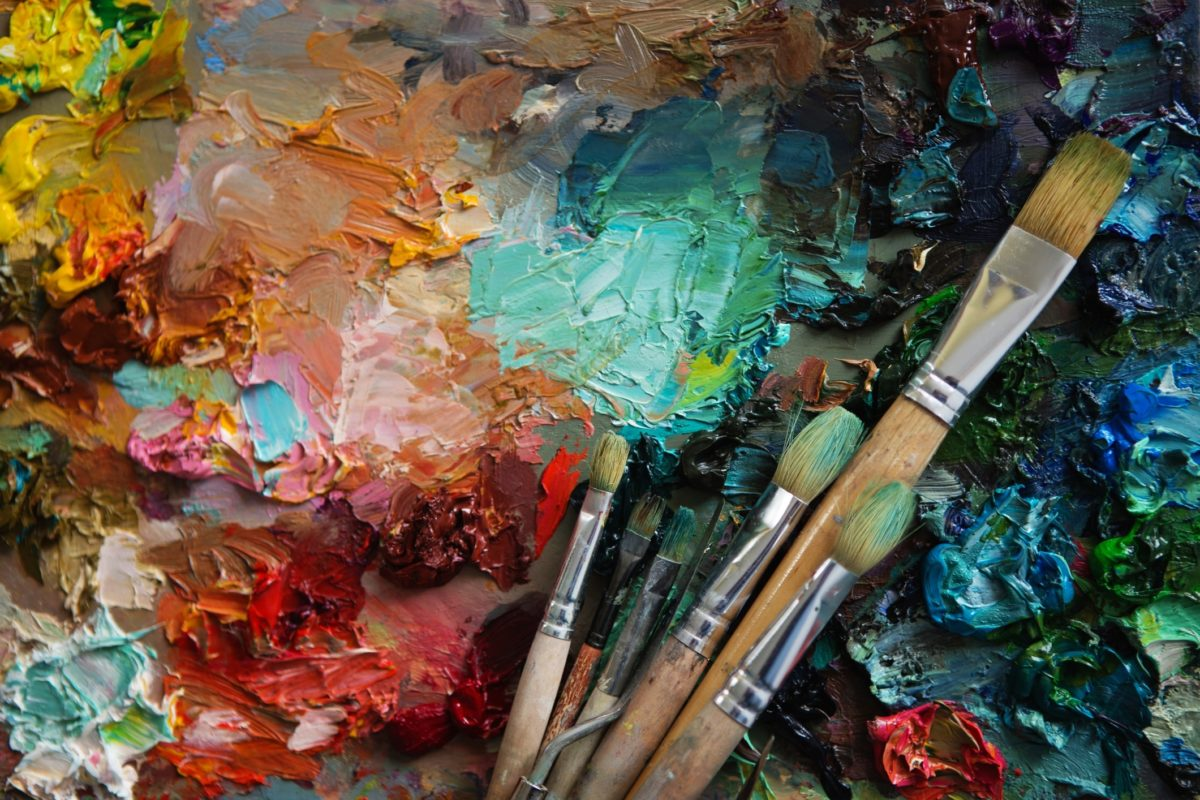 Vintage stylized photo of paintbrushes closeup and artist palett 577949148 2125x1416