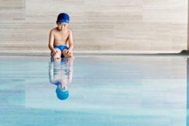 Little boy sitting by pool 803131666 1735x1735