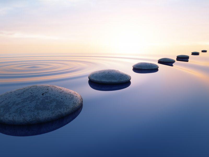 Pebbles in wide calm Ocean 1183897499 2649x1135